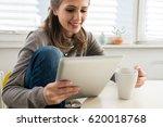 surfing on digital tablet | Shutterstock . vector #620018768