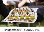 waiter serving canapes. outdoor ... | Shutterstock . vector #620020448