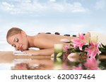 woman relaxing in spa  with... | Shutterstock . vector #620037464