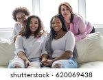 two family friends sitting on... | Shutterstock . vector #620069438