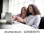 a mother and teenage daughter... | Shutterstock . vector #620083070
