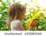 happy little girl smelling a... | Shutterstock . vector #620083244