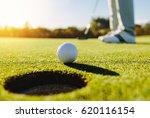 Professional Golfer Putting...