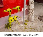 Painted Dog Figure In Yellow...