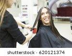 hairdresser cutting client's... | Shutterstock . vector #620121374