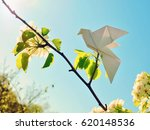 paper birds on a blooming tree. | Shutterstock . vector #620148536