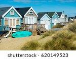 Beach Huts And Boats  At...