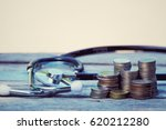 coins and stethoscope on old... | Shutterstock . vector #620212280