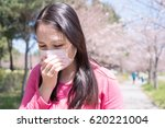 woman feel pain and wear mask... | Shutterstock . vector #620221004