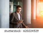 indian male walking at airport   | Shutterstock . vector #620224529