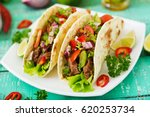 mexican tacos with beef in... | Shutterstock . vector #620253734