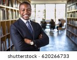 Stock photo cheerful happy confident african american business man attorney legal representative with arms 620266733