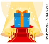 big blue gift box on luxurious... | Shutterstock .eps vector #620309540