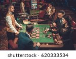 upper class friends gambling in ... | Shutterstock . vector #620333534