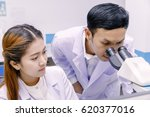 scientist using a microscope in ... | Shutterstock . vector #620377016