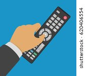 tv remote control in hand.... | Shutterstock .eps vector #620406554
