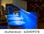 empty bar stools along bar... | Shutterstock . vector #620409578