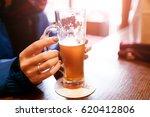 woman drinks fresh beer in cafe | Shutterstock . vector #620412806