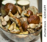 Fresh mushrooms from forest in kitchen - stock photo