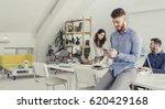 businessman using phone at... | Shutterstock . vector #620429168