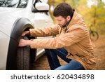young bearded man checking car... | Shutterstock . vector #620434898