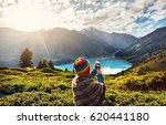 tourist woman in rainbow hat... | Shutterstock . vector #620441180