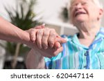 hands of young woman holding... | Shutterstock . vector #620447114