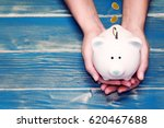 women hold a pig bank and a... | Shutterstock . vector #620467688