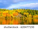 autumn forest river reflection... | Shutterstock . vector #620477150