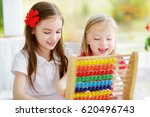 two cute little girls playing... | Shutterstock . vector #620496743