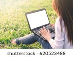 the girl is using a laptop in a ... | Shutterstock . vector #620523488