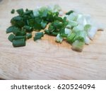 chopped spring onion on wooden...   Shutterstock . vector #620524094