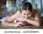 happy woman using a mobile... | Shutterstock . vector #620530844