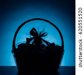 gift basket silhouette on blue... | Shutterstock . vector #620551520
