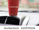 a cup of coffee on a dashboard. ... | Shutterstock . vector #620555636