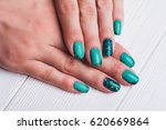 turquoise nail art with tinsels ... | Shutterstock . vector #620669864