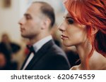 stylish bride crying during... | Shutterstock . vector #620674559