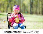 beautiful child girl with a cup ... | Shutterstock . vector #620674649