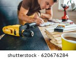 yellow power drill and man... | Shutterstock . vector #620676284