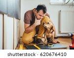 man doing renovation work at...   Shutterstock . vector #620676410