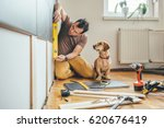 man doing renovation work at... | Shutterstock . vector #620676419