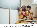 man doing renovation work at... | Shutterstock . vector #620676428