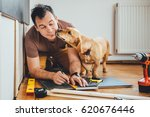 man doing renovation work at... | Shutterstock . vector #620676446