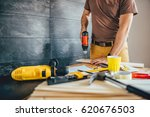 man drilling wood with battery... | Shutterstock . vector #620676503