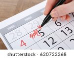 woman writing baby on date in... | Shutterstock . vector #620722268