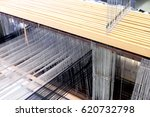 Small photo of Wooden shaft frame , Lam, and heddle support hooks of a loom.