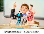 schoolboy looking in the... | Shutterstock . vector #620784254