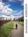 Small photo of POZNAN, POLAND - APRIL 13, 2017: Unidentified young boy on child scooter on a footpath along a road
