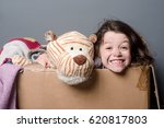 toothy girl sitting in a paper... | Shutterstock . vector #620817803