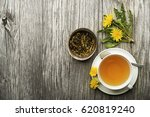 cup of healthy dandelion tea on ... | Shutterstock . vector #620819240
